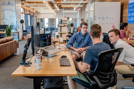 Agency meeting at desk