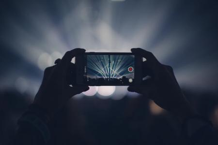 Phone videoing concert